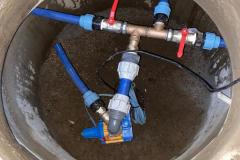 Brunnendom mit Pumpeninstallation